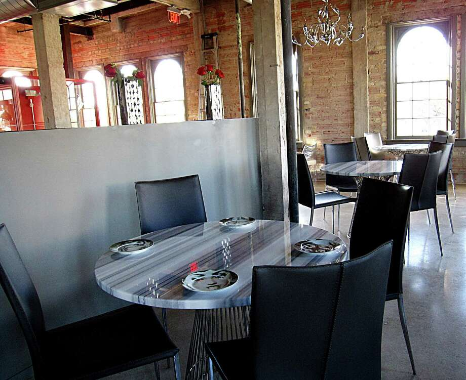The upstairs dining room at Battalion gets a steady stream of sunlight from expansive original windows. Photo: Mike Sutter, San Antonio Express-News