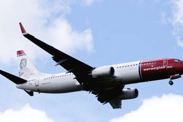 A file photo taken on July 17, 2009 shows a Boeing 737-800 of Low-cost airline Norwegian flying near Oslo airport in Gardermoen. Norwegian said on January 25, 2012 it had ordered 122 Boeing 737s and 100 Airbus A320neos with a list price of 127 billion kroner (16.6 billion euros, 21.6 billion US dollars) in what it described as a landmark deal.        AFP PHOTO / KYRRE LIEN (Photo credit should read KYRRE LIEN/AFP/Getty Images)