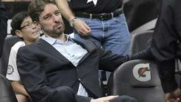 San Antonio Spurs center Pau Gasol watches from the bench during the second half of an NBA basketball game against the Orlando Magic in Orlando, Fla., Wednesday, Feb. 15, 2017. The Spurs won 107-79. (AP Photo/Phelan M. Ebenhack)