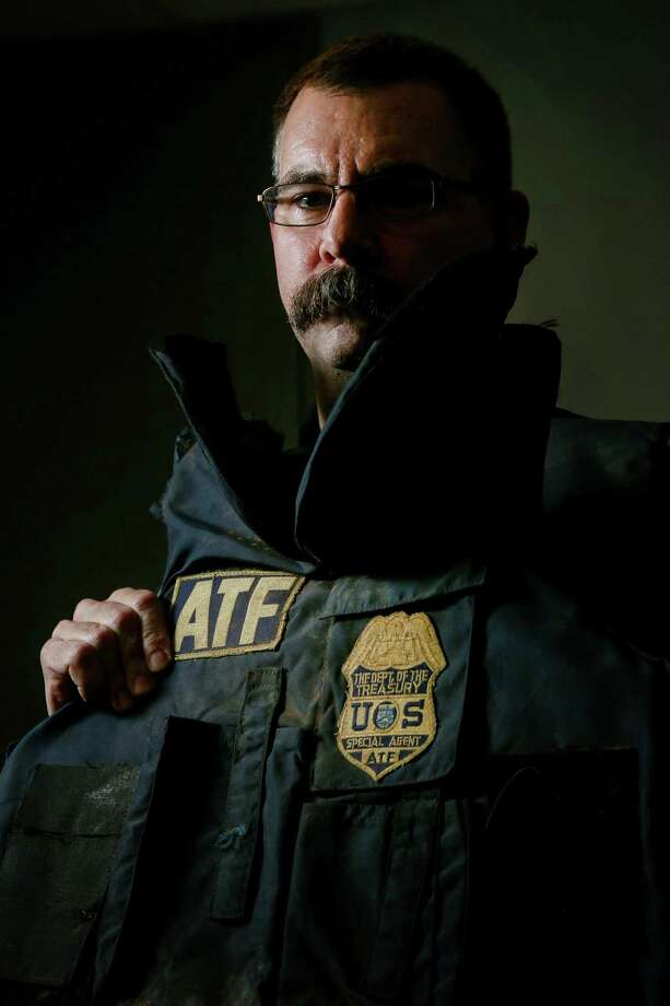 ATF Special Agent Eric Evers poses for a portrait with a body armor vest he wore during the raid on the Branch Davidian compound in 1993, Monday, Jan. 9, 2017, in Houston. The vest stopped three of the five rounds that hit Evers. ( Jon Shapley / Houston Chronicle ) Photo: Jon Shapley, Staff / Houston Chronicle / © 2017  Houston Chronicle