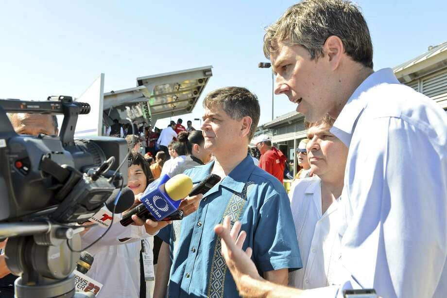 On the left is Congressman Filemon Vela Jr, D- Brownsville, and right is Congressman Beto O'Rourke, D-El Paso, on Thursday morning speaking to reporters during the Hands Across the Border ceremony at the Gateway International Bridge, part of the annual Charro Days fiesta. Photo: Miguel Roberts /Brownsville Herald / Copyright 2015