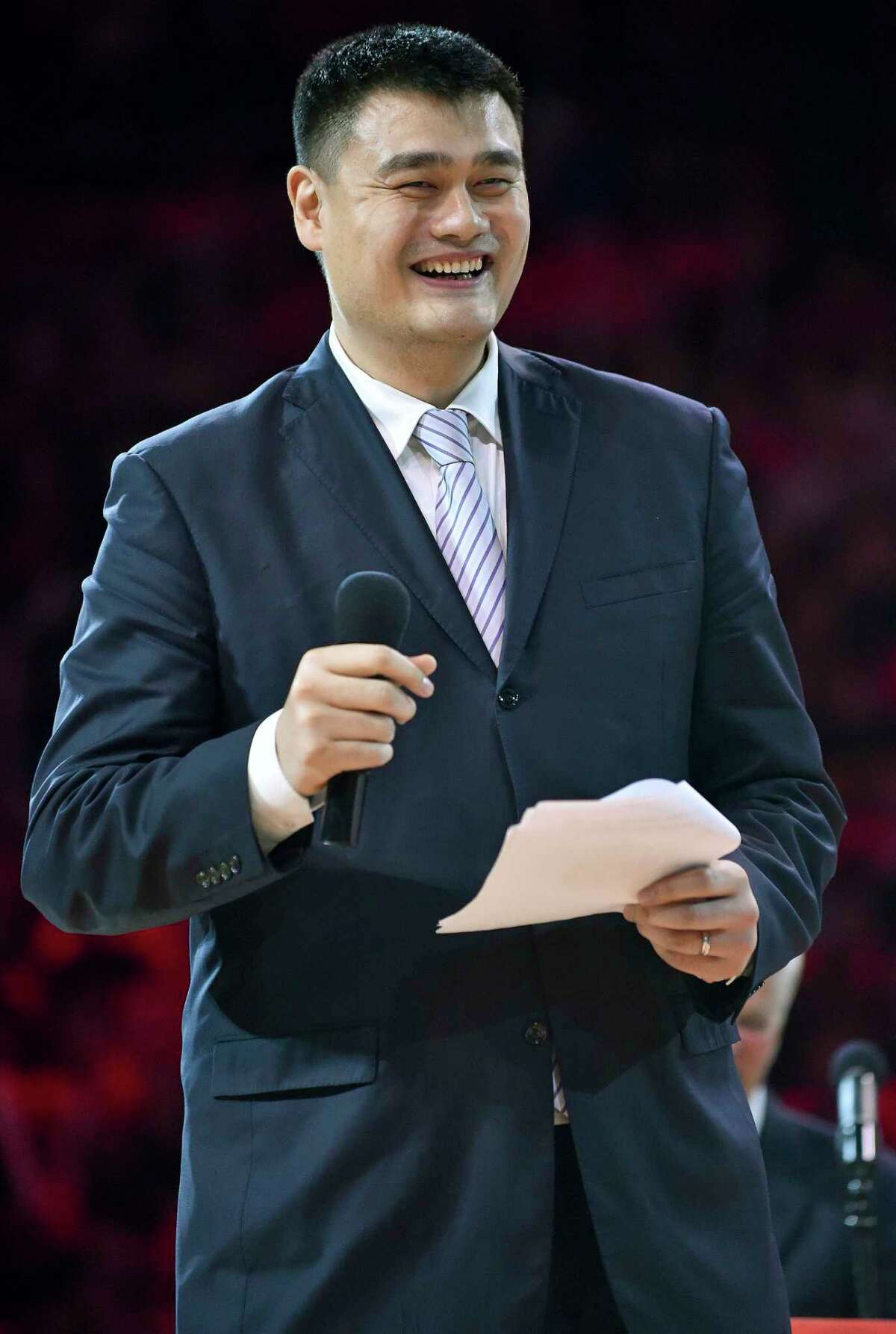 FILE - In this Friday, Feb. 3, 2017 file photo, retired Houston Rockets center Yao Ming speaks during his jersey number retirement ceremony at halftime of an NBA basketball game between the Rockets and the Chicago Bulls in Houston. The Chinese Basketball Association has voted unanimously to appoint NBA Hall of Famer Yao as its new president. (AP Photo/Eric Christian Smith, File)