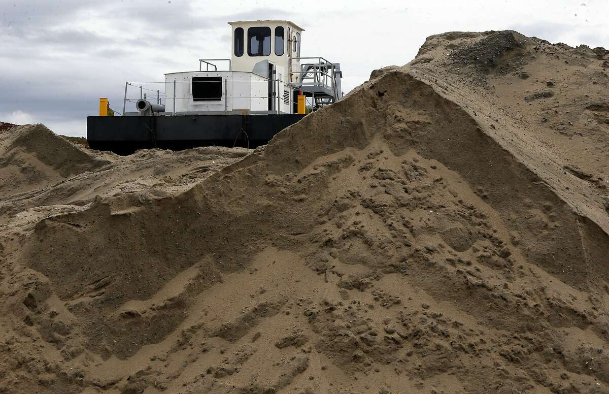 A dredge owned by Cemex sits atop a berm along the Monterey Bay coastline in Marina, Ca., as seen on Wednesday Feb. 8, 2017. The Cemex Lapis Plant removes more than 200,000 acre feet of beach sand a year.