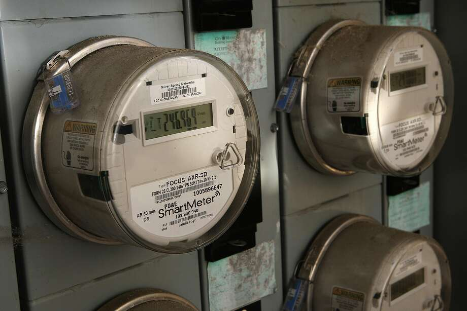 PG&E's smart meters shown on a home in Mountain View. Come March, some 250,000 Californians scattered across the utility's vast service territory will begin paying different prices for power at different times of day. Photo: Liz Hafalia, The Chronicle