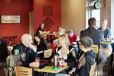 BRITTNEY LOHMILLER | blohmiller@mdn.net Midland residents Gwen Malone, center, and Stephanie Thomas, right, chat with Midland Police Chief Clifford Block at Coffee Chaos Thursday morning during the first Coffee with a Cop.