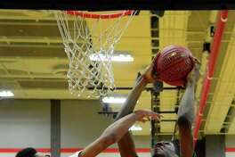 Bassick's Jaelin Gallimore goes up to the basket as Central's D.J. Fulton defends in a game earlier this month.