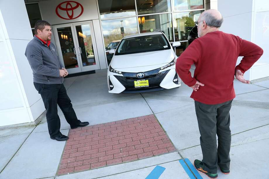 Bob Plantz (right) takes a look at a Toyota Prius with Hansel Toyota's Cameron Hart in Petaluma. Photo: Scott Strazzante, The Chronicle