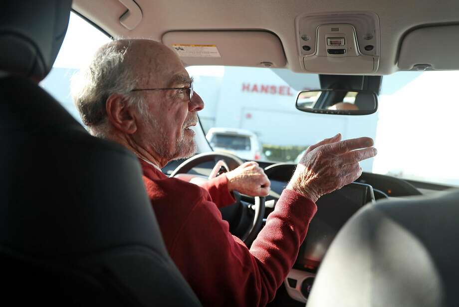 Bob Plantz test drives a Toyota Prius Prime, but he is uncertain whether federal tax credits for the vehicles will continue. Photo: Scott Strazzante, The Chronicle
