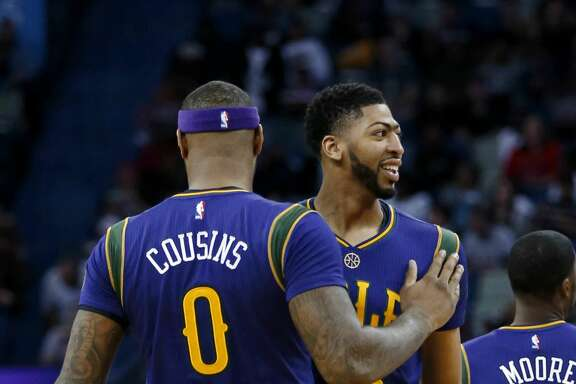 New Orleans Pelicans forward DeMarcus Cousins (0) pats forward Anthony Davis (23) during the first half of the team's NBA basketball game against the Houston Rockets in New Orleans, Thursday, Feb. 23, 2017. (AP Photo/Gerald Herbert)