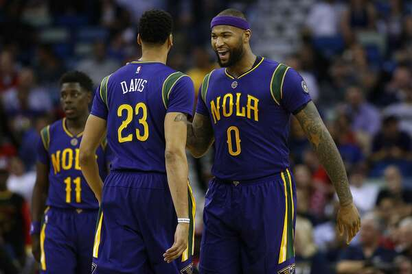 NEW ORLEANS, LA - FEBRUARY 23: DeMarcus Cousins #0 of the New Orleans Pelicans and Anthony Davis #23 react during the first half of a game against the Houston Rockets at the Smoothie King Center on February 23, 2017 in New Orleans, Louisiana. NOTE TO USER: User expressly acknowledges and agrees that, by downloading and or using this photograph, User is consenting to the terms and conditions of the Getty Images License Agreement.  (Photo by Jonathan Bachman/Getty Images)