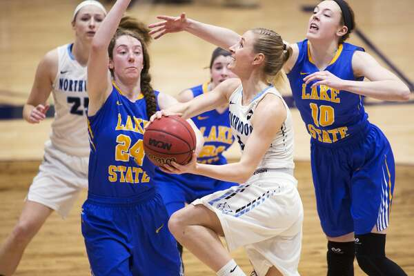 Northwood's Delaney Kenny shoots the ball while being defended by Lake Superior State's Lexie Khon and Rachel Novotny in a game at Northwood University on Thursday.