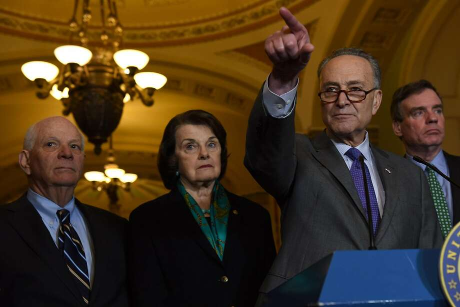 Senate Minority Leader Chuck Schumer, D-N.Y., holds a news conference with from left, Sens. Ben Cardin, D-Md., Dianne Feinstein, D-Calif., and Mark R. Warner, D-Va. MUST CREDIT: Washington Post photo by Michael Robinson Chavez Photo: Michael Robinson Chavez, The Washington Post