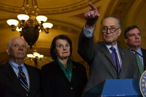 Senate Minority Leader Chuck Schumer, D-N.Y., holds a news conference with from left, Sens. Ben Cardin, D-Md., Dianne Feinstein, D-Calif., and Mark R. Warner, D-Va. MUST CREDIT: Washington Post photo by Michael Robinson Chavez