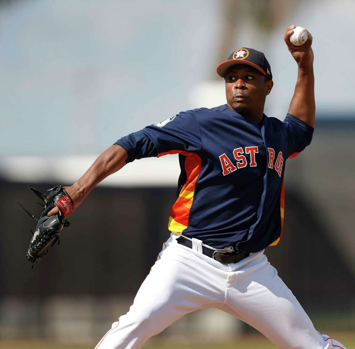 In trying to get more of his split-finger pitches in the strike zone in 2016, left, Astros reliever Tony Sipp overcompensated by adapting an over-the-top arm slot. This spring, right, he's looking to go back to the the three-quarter slot that made him much more effective in 2015.