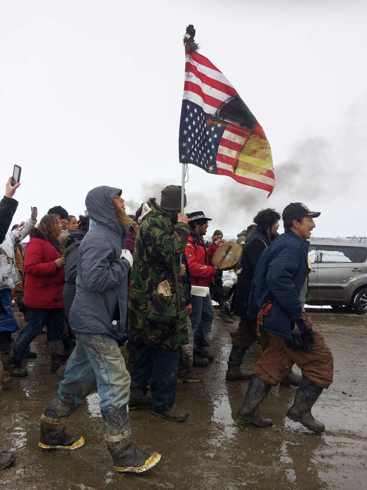 People peacefully leave the Dakota Access pipeline main protest camp near Cannon Ball, N.D., as authorities prepare to shut it down in advance of the spring flooding season. The Army Corps of Engineers ordered the camp closed at 2 p.m. Wednesday. (AP Photo/Blake Nicholson) ORG XMIT: RPBN107