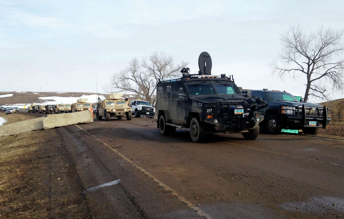 Law enforcement vehicles arrive at the closed Dakota Access pipeline protest camp near Cannon Ball, N.D., Thursday, Feb. 23, 2017, where dozens of people remain. Most protesters left peacefully Wednesday when authorities closed the camp on Army Corps of Engineers land in advance of spring flooding, but some are refusing to go. (AP Photo/James MacPherson) ORG XMIT: RPBN301
