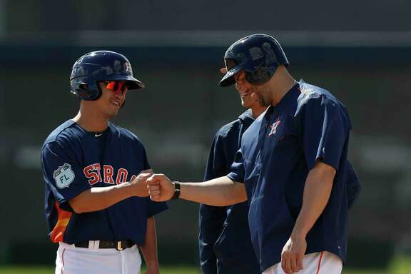 The international language of the fist bump bonds Astros free-agent signees Nori Aoki, left, and Carlos Beltran on Thursday at The Ballpark of the Palm Beaches.