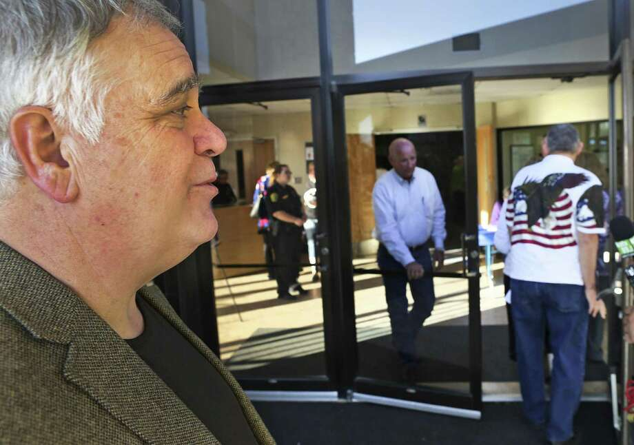 Dr. Steven Branson, Senior Pastor at Village Parkway Baptist Church, stands near the door where people enter to attend a meeting of ACT San Anotnio on Thursday, Feb. 23, 2017.  A group of over 50 protestors gathered outside thec hurch during the meeting. Photo: Bob Owen, Staff / San Antonio Express-News / ©2017 San Antonio Express-News