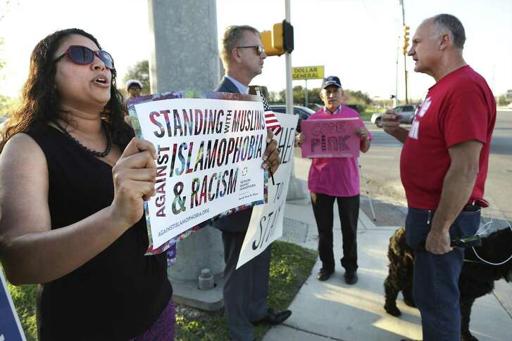 Siri Gurubhagavathula (left) and others protest a meeting held by ACT for America at Village Parkway Baptist Church.