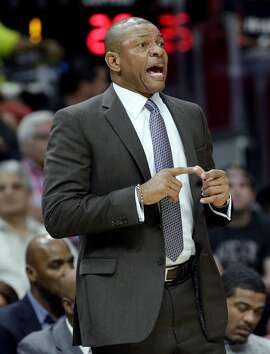 LA Clippers head coach Doc Rivers watches the action during the first half of an NBA basketball game against the Miami Heat, Friday, Dec. 16, 2016, in Miami. (AP Photo/Lynne Sladky)