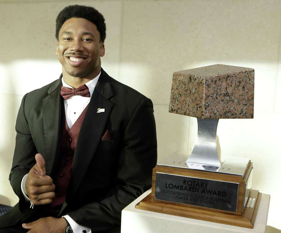 Texas A&M Aggies defensive lineman, Myles Garrett, poses with the Rotary Lombardi Award at the Hobby Center,  800 Bagby, shown Saturday, Feb. 11, 2017, in Houston. The four Rotary Lombardi Award candidates are Jonathan Allen, University of Alabama, Lamar Jackson University of Louisville,  Jabrill Peppers University of Michigan, and Myles Garrett of Texas A & M University. ( Melissa Phillip / Houston Chronicle ) Photo: Melissa Phillip, Staff / Houston Chronicle / © 2017 Houston Chronicle