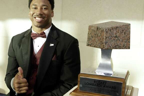 Texas A&M Aggies defensive lineman, Myles Garrett, poses with the Rotary Lombardi Award at the Hobby Center,  800 Bagby, shown Saturday, Feb. 11, 2017, in Houston. The four Rotary Lombardi Award candidates are Jonathan Allen, University of Alabama, Lamar Jackson University of Louisville,  Jabrill Peppers University of Michigan, and Myles Garrett of Texas A & M University. ( Melissa Phillip / Houston Chronicle )