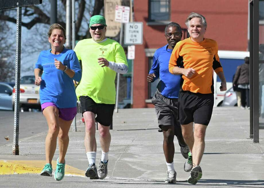 From left, retired state worker Nina Knapp came back to run with her state worker running buddies Brian Browne, Ian Ushe, and Henry Spliethoff making their way down Madison Ave. on an unseasonable warm day Thursday, Feb. 23, 2017 in Albany, N.Y. (Lori Van Buren / Times Union) Photo: Lori Van Buren / 20039713A