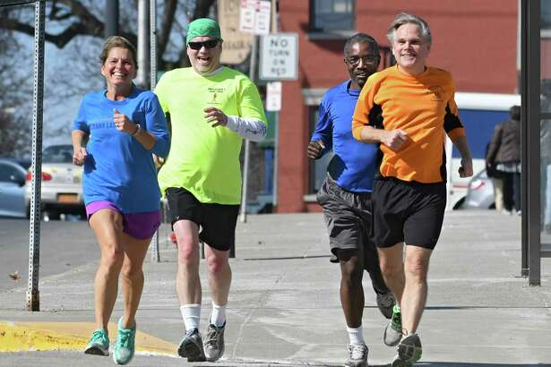 From left, retired state worker Nina Knapp came back to run with her state worker running buddies Brian Browne, Ian Ushe, and Henry Spliethoff making their way down Madison Ave. on an unseasonable warm day Thursday, Feb. 23, 2017 in Albany, N.Y. (Lori Van Buren / Times Union)