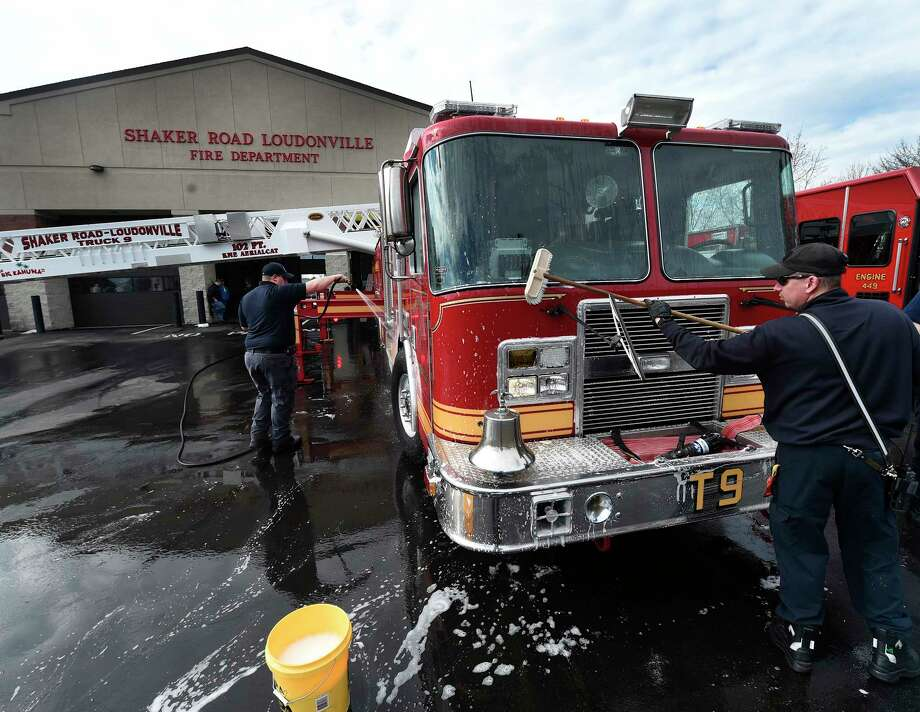 Members of the paid staff of the Shaker Road Loudonville Fire Department take the opportunity to wash their apparatus on an unseasonably warm weather Thursday Feb. 23, 2017 in Loudonville, N.Y.  Firefighter Andrew Buckley, left and Chris Laird get the soap and water on their trucks and engines.  (Skip Dickstein/Times Union) Photo: SKIP DICKSTEIN / 40039744A