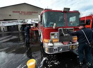 Members of the paid staff of the Shaker Road Loudonville Fire Department take the opportunity to wash their apparatus on an unseasonably warm weather Thursday Feb. 23, 2017 in Loudonville, N.Y.  Firefighter Andrew Buckley, left and Chris Laird get the soap and water on their trucks and engines.  (Skip Dickstein/Times Union)