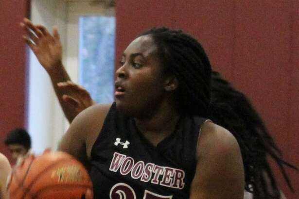Wooster's Venus Okwuka pulls down a rebound during the HVAL semifinal girls basketball game against Christian Heritage at Wooster's Forever Young Gymnasium Feb. 23, 2017.