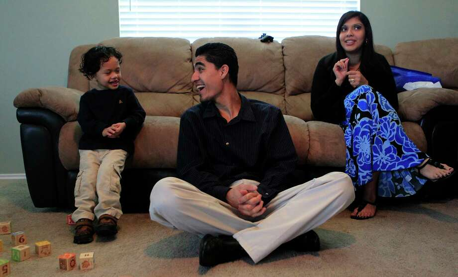 Jose Escobar shares a laugh with his son, Walter, and wife, Rose Escobar, at their south Houston home in January 2012. At that time, he just survived a scare with immigration authorities.  Photo: Johnny Hanson, Staff / © 2012  Houston Chronicle