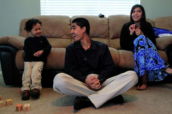Jose Escobar shares a laugh with his son, Walter, and wife, Rose Escobar, at their south Houston home in January 2012. At that time, he just survived a scare with immigration authorities.