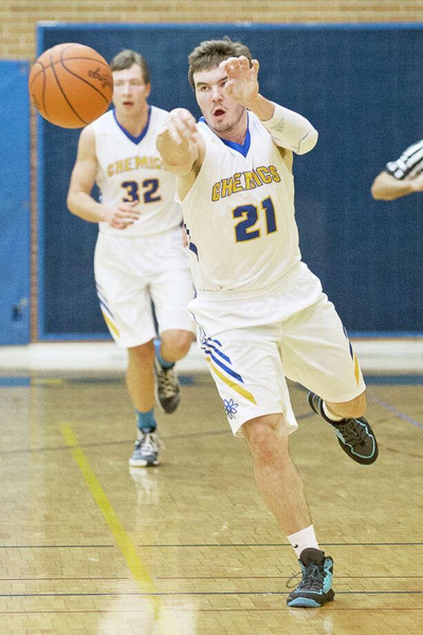 ERIN KIRKLAND | ekirkland@mdn.net Midland's Martin Money passes the ball on Thursday at Midland High School. / Midland Daily News