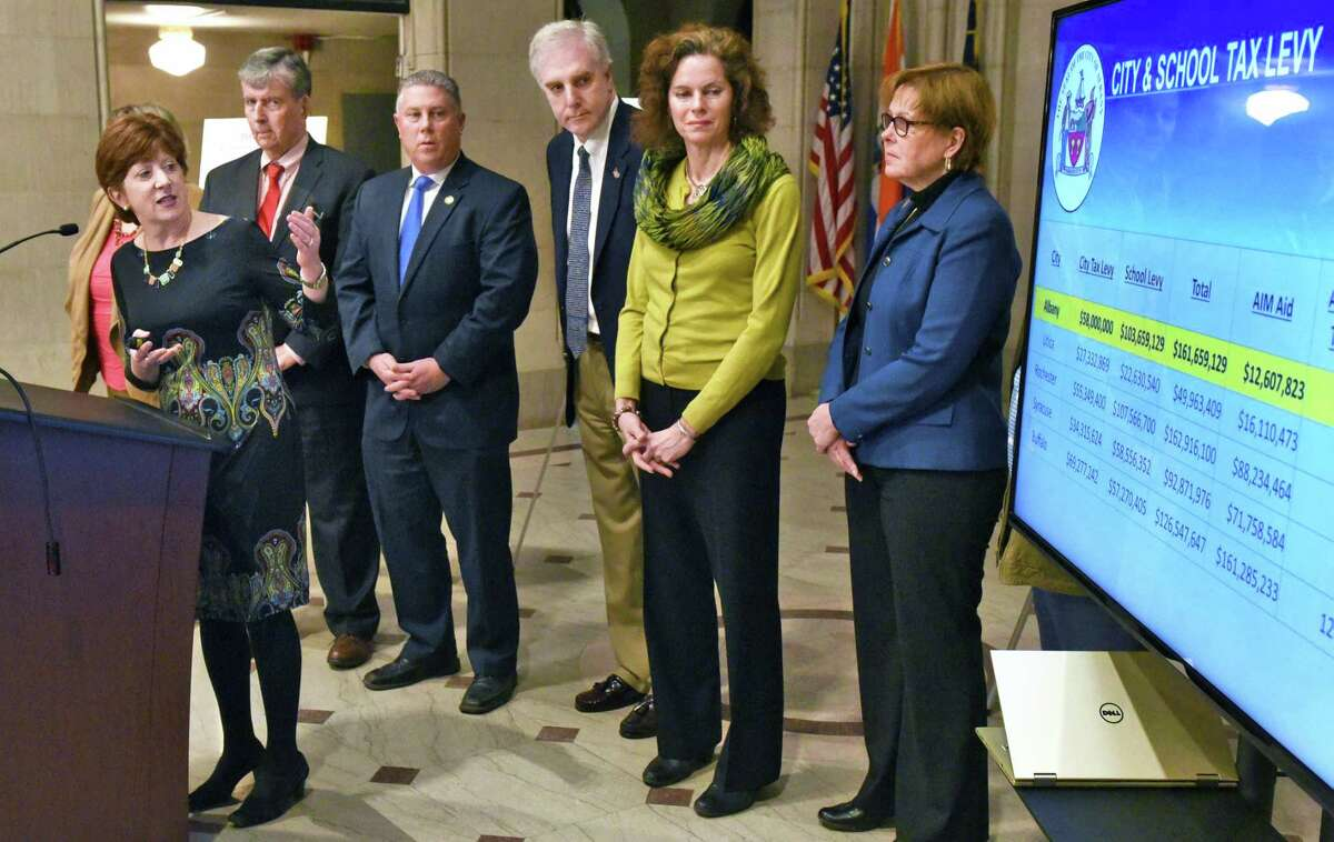 Mayor Kathy Sheehan, left, is joined by state and city officials to outline an advocacy campaign for Capital City Funding during a City Hall news conference Thursday, Feb. 23, 2017 in Albany, NY. (John Carl D'Annibale / Times Union)