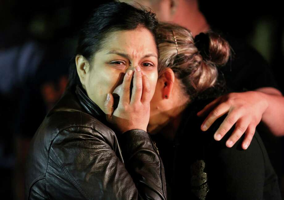 The mother of Javier Flores grieves at a vigil for him Thursday night. Flores was killed Wednesday when armed robbers targeted the southeast Houston Subway store where he and his mother were working. Photo: Yi-Chin Lee, Staff / © 2017  Houston Chronicle
