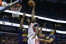 NEW ORLEANS, LA - FEBRUARY 23: Nene Hilario #42 of the Houston Rockets shoots against Dante Cunningham #33 of the New Orleans Pelicans and Anthony Davis #23 during the second half of a game at the Smoothie King Center on February 23, 2017 in New Orleans, Louisiana. NOTE TO USER: User expressly acknowledges and agrees that, by downloading and or using this photograph, User is consenting to the terms and conditions of the Getty Images License Agreement.  (Photo by Jonathan Bachman/Getty Images)