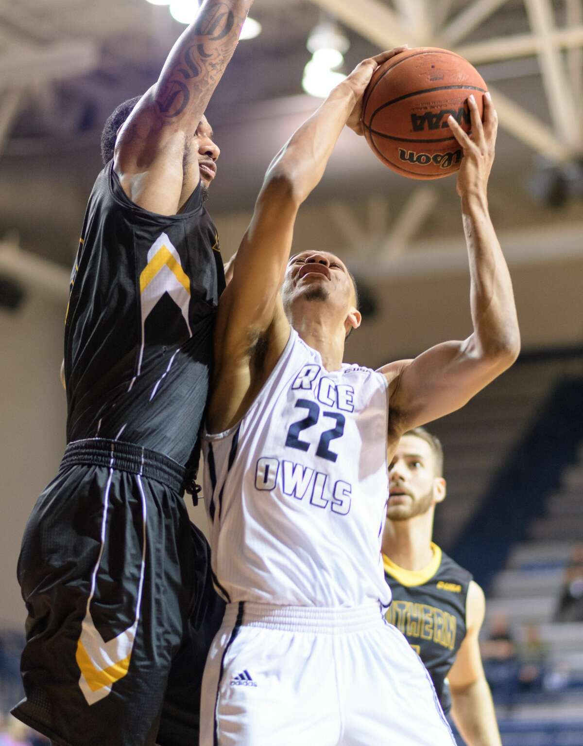 Marcus Jackson (22) of the Rice Owls drives for a layup against the Southern Miss Golden Eagles in a college basketball game on Thursday, February 23, 2017 at Tudor Fieldhouse on Rice Campus.