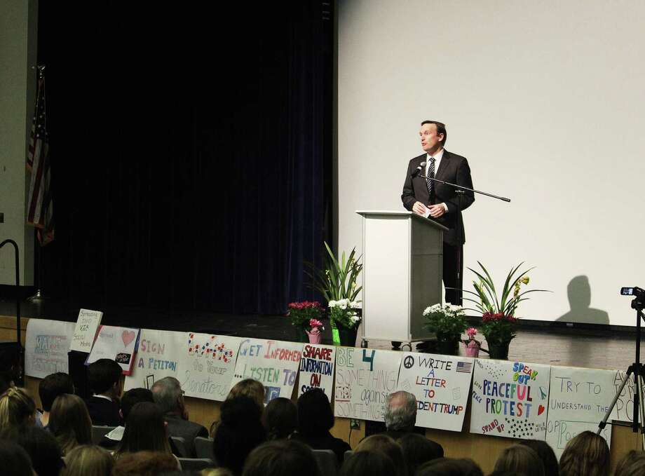 Sen. Christopher Murphy, D-Conn., speaks on a stage lined with GIVE Campaign student signs during a town hall meeting organized by the group at Fairfield Ludlowe High School in Fairfield, Conn. on Feb. 23, 2017. Photo: Laura Weiss / Hearst Connecticut Media / Fairfield Citizen