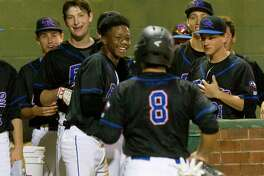 Oak Ridge's Logan Letney (8) celebrates with teammates after scoring on an RBI single by Ryan Eshelman during the first inning of a baseball game at the War Eagle Classic at Oak Ridge High School Thursday, Feb. 23, 2017, in Conroe.