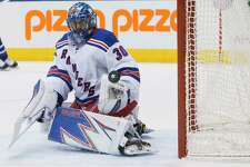 New York Rangers goalie Henrik Lundqvist pushes a shot wide during the third period of an NHL hockey game against Toronto in Toronto on Thursday, Feb. 23, 2017. New York won, 2-1, in shootout. (Chris Young/The Canadian Press via AP) ORG XMIT: CHY124