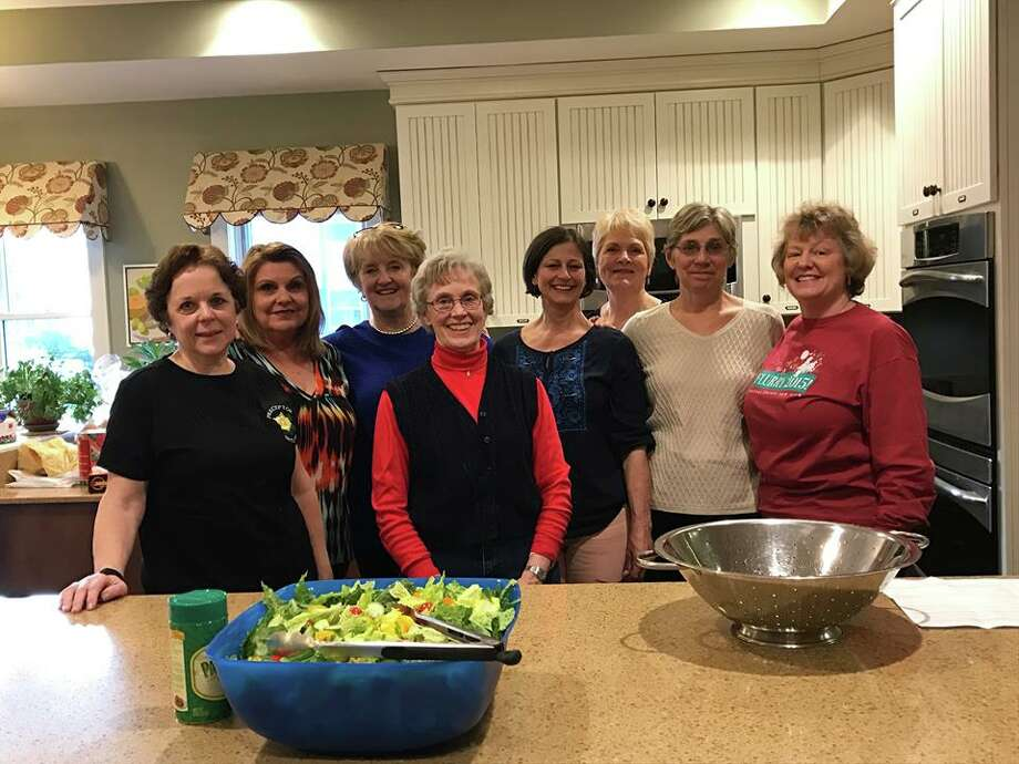 Members of Preceptor Beta Psi chapter in Clifton Park, an affiliate of Beta Sigma Phi International, make dinner for 45 residents of Ronald McDonald House in Albany, which is a welcoming home for families experiencing medical issues. Photo: Submitted Photo