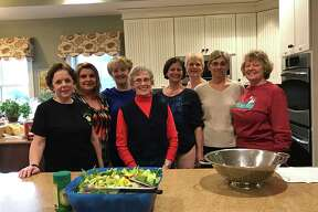 Members of Preceptor Beta Psi chapter in Clifton Park, an affiliate of Beta Sigma Phi International, make dinner for 45 residents of Ronald McDonald House in Albany, which is a welcoming home for families experiencing medical issues.