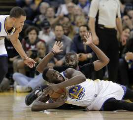 Draymond Green (23) grapples for the ball against Raymond Felton (2) after Stephen Curry (30) stole it in the first half as the Golden State Warriors played the Los Angeles Clippers at Oracle Arena in Oakland, Calif., on Thursday, February 23, 2017.