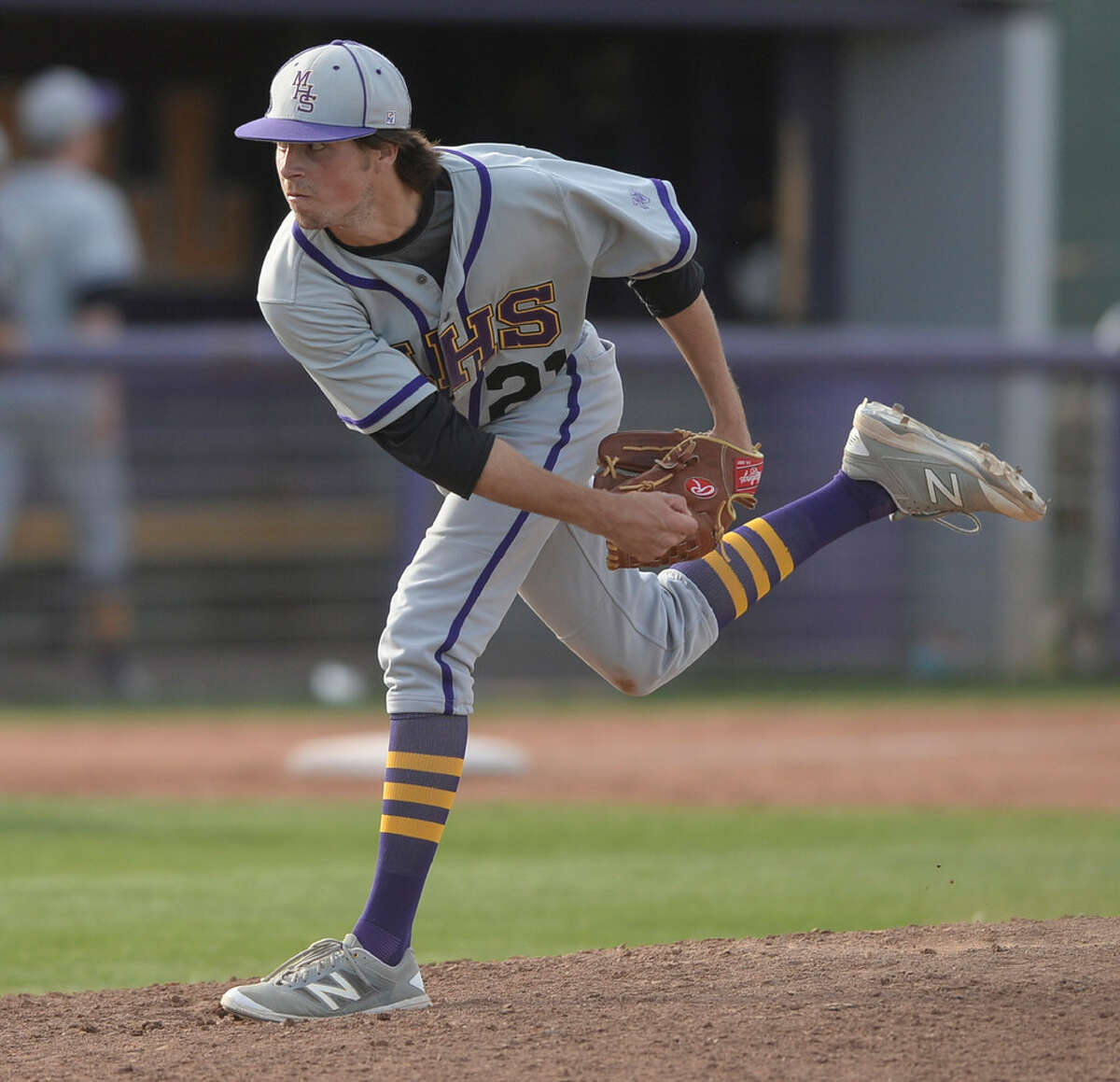 Midland High's Brooks Betcher (21) pitches against San Angelo on Tuesday, March 22, 2016, at Zachery Field. James Durbin/Reporter-Telegram