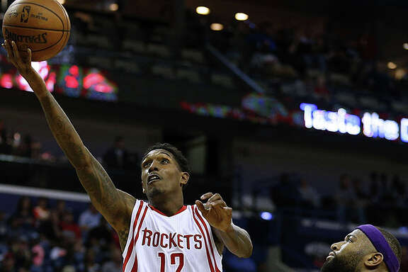 NEW ORLEANS, LA - FEBRUARY 23: Lou Williams #12 of the Houston Rockets scores past DeMarcus Cousins #0 of the New Orleans Pelicans during the second half of a game at the Smoothie King Center on February 23, 2017 in New Orleans, Louisiana. NOTE TO USER: User expressly acknowledges and agrees that, by downloading and or using this photograph, User is consenting to the terms and conditions of the Getty Images License Agreement.  (Photo by Jonathan Bachman/Getty Images)