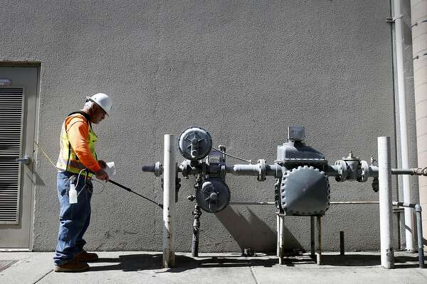 Mark Kollman checked a large business meter for gas leaks in downtown Napa, Calif Monday August 25, 2014. Residents and shop owners in Napa, Calif. spent the day cleaning up or moving out after the large earthquake Sunday.