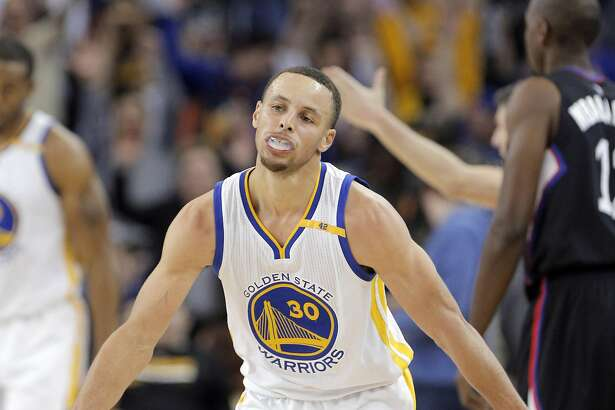 Stephen Curry (30) celebrates after hitting a three-pointer and getting fouled in the second half as the Golden State Warriors played the Los Angeles Clippers at Oracle Arena in Oakland, Calif., on Thursday, February 23, 2017.