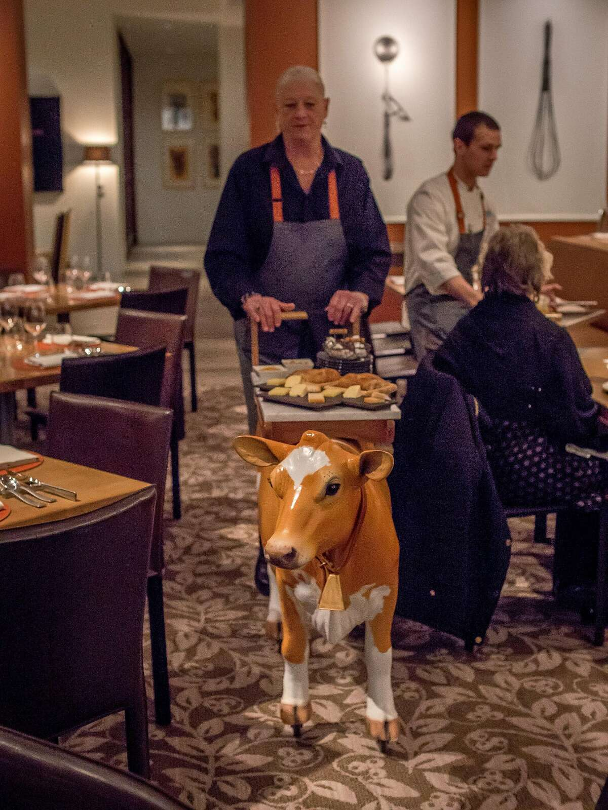 Server Lillian Wiggins rolls around Bessie the Cheese Cart at CIA at Copia in Napa, Calif. on February 23rd, 2017.