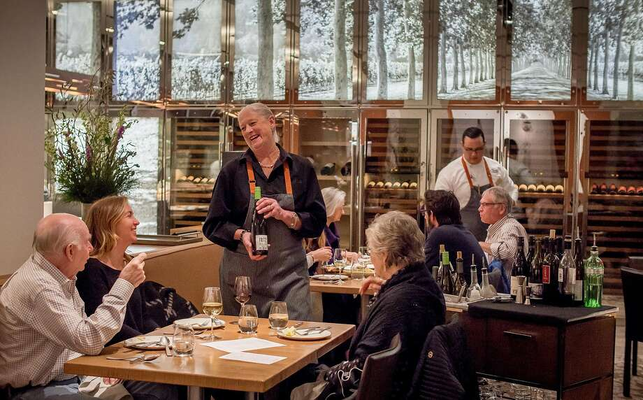 Server Lillian Wiggins offers wine to diners at CIA at Copia in Napa, Calif. on February 23rd, 2017. Photo: John Storey, Special To The Chronicle